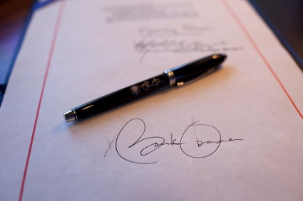 Close-up detail of President Obama's signature on a bill, and a pen used for the signing, aboard Air Force One on a flight from Buckley Air Force Base, Denver Colorado to Phoenix, Arizona 2/17/09. Official White House Photo by Pete Souza