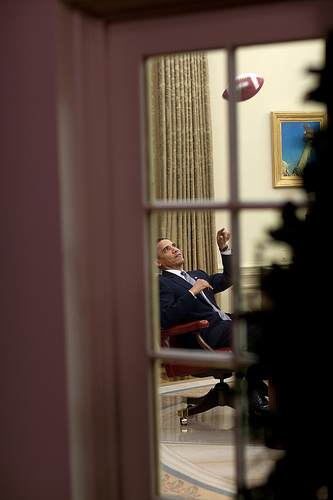 President Barack Obama plays with a football in the Oval Office 4/23/09. Official White House Photo by Pete Souza